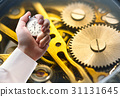 Clock inside mechanism and stopwatch in male hand 31131645