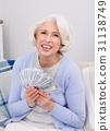 Elderly woman with money 31138749