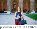 A young woman in front of university building 31139829