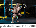 Bodybuilder exercising with weights 31139988
