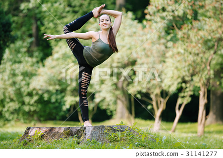 Beautiful gymnast exerciser in nature 31141277