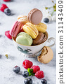 Variety of french dessert macaroons 31143409