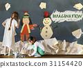Children having fun with snowman artwork 31154420