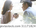 A couple is happily dating at a coffee shop. 31171824