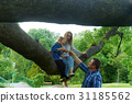 A happy family spend time in a park 31185562