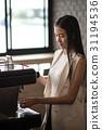 Woman barista preparing coffee at the coffee shop 31194536