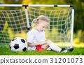 Cute little soccer player having fun 31201073