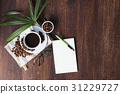 coffee cup and beans on the wood background. 31229727
