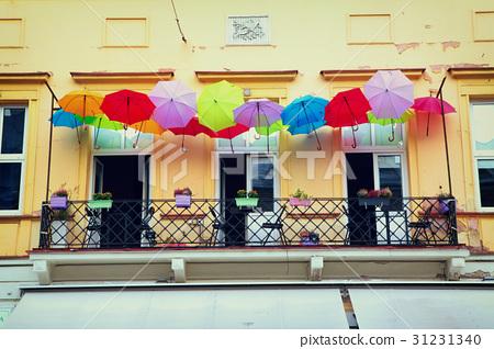 balcony with colorful umbrellas 31231340