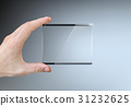 hand holding a transparent touch screen 31232625