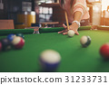 Young women playing pool 31233731