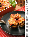 Roasted eggplants stuffed with minced meat . 31234789