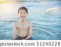 Young asian boy smiling in the sea 31240228