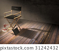 Director's chair in dark room with spotlight light 31242432