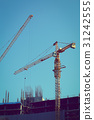 machinery crane working in construction site 31242555