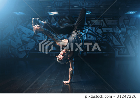 Breakdance action, dancer posing in dance studio 31247226