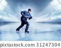 Professional ice hockey player shooting 31247304