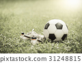 football on grass and stud shoe on vintage tone 31248815