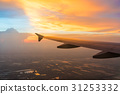 Sunset in twilight time with Wing of an airplane  31253332