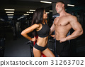 beautiful young sporty sexy couple showing muscle and workout gy 31263702