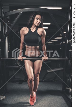 Girl execute exercise with barbell 31263707