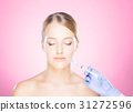 Woman on a face skin operation with a syringe 31272596