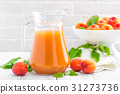 Apricot juice and fresh fruits with leaves 31273736