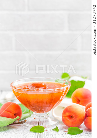 Apricot jam and fresh fruits with leaves 31273742