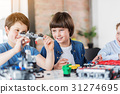 Interested smiling children making technical toy 31274695