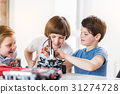 Interested smiling children making technical toy 31274728