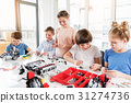 Cheerful smiling children constructing lego 31274736