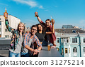 Cheerful young people hanging out on rooftop 31275214