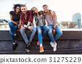 Joyful young people relaxing on rooftop terrace 31275229