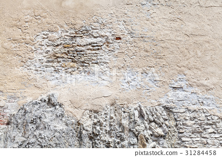 Old brick wall with damaged stucco layer 31284458