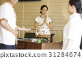 a receptionist is greeting guest by Thai style. 31284674
