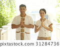 A photo of hotel staff smiling and welcoming in Thai style. 31284736