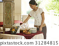 Hotel waitress is preparing the table at restaurant 31284815