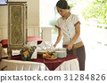 Hotel staff is arranging the dining table 31284826