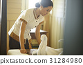 A housekeeper is hard-working at her workplace. 31284980