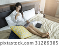Asia woman working on bed with laptop. 31289385