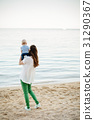 mother with child relax on beach 31290367