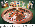 Casino roulette wheel with casino chips on green 31290873