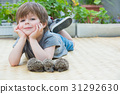 Little boy playing with hedgehog 31292630