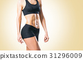 Fit, healthy and sporty woman in sportswear 31296009