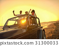 Five young people having fun in convertible car at 31300033