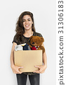 Woman Studio Portriat Casual Carrying a Box Isolated 31306183