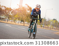 Young slender woman bicycle in the park. 31308663