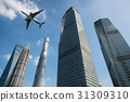 Shanghai skyscrapers buildings and a plane flying  31309310