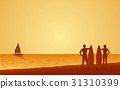 Silhouette couple surfer carrying surfboard 31310399