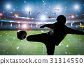 silhouette soccer player kicking the ball 31314550